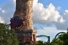 Islands of Adventure sign and roller coaster at Universal Studios city walk. Orlando, Florida; July 27, 2018 Islands of Adventure sign and roller coaster at stock photos