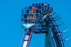 People having fun riding Mako rollercoaster during summer vacation at Seaworld 3