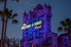 The Twilight zone Tower of Terror and palm trees on blue sky background in Hollywood Studios at Walt Disney World  7. Orlando, Florida. Jun 06, 2019.The Twilight stock photo