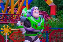 Buzz Lightyear on colorful background in Hollywood Studios at Walt Disney World area  2. Orlando, Florida. March 29, 2019. Buzz Lightyear on colorful background stock photos