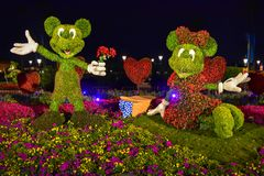 Mickey and Minnie topiaries on a colorful scenery at Epcot in Walt Disney World 1