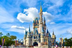 Panoramic view of Cinderella`s Castle on lightblue cloudy sky background in Magic Kingdom at Walt Disney World  1