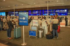People using United Airlines Self service check-in at Orlando International Airport.