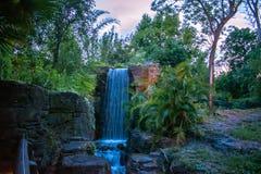 Beautiful waterfalls on rainforest background at  Animal Kingdom. Orlando , Florida. May 03, 2019. Beautiful waterfalls on rainforest background at  Animal stock photography