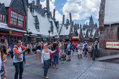 ORLANDO, FLORIDA - MAY 06, 2015: Butterbeer and Harry Potter Hogsmeade in Universal Orlando, Florida. People Doing Selfies. Butterbeer and Harry Potter Stock Photo