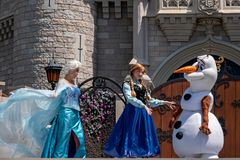 Elsa and Anna on Mickey`s Royal Friendship Faire on Cinderella Castle in Magic Kingdom at Walt Disney World Resort  3. Orlando, Florida. May 17, 2019. Elsa and royalty free stock image
