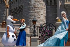 Elsa , Anna and Olaf on Mickey`s Royal Friendship Faire on Cinderella Castle in Magic Kingdom at Walt Disney World Resort  7. Orlando, Florida. May 17, 2019 stock image