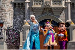 Elsa, Minnie and Mickey on  Mickey`s Royal Friendship Faire on Cinderella Castle in Magic Kingdom at Walt Disney World Resort  3. Orlando, Florida. May 17, 2019 stock photos