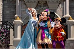 Elsa, Minnie and Mickey on Mickey`s Royal Friendship Faire on Cinderella Castle in Magic Kingdom at Walt Disney World Resort  8. Orlando, Florida. May 17, 2019 stock photos