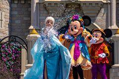 Elsa, Minnie and Mickey on  Mickey`s Royal Friendship Faire on Cinderella Castle in Magic Kingdom at Walt Disney World Resort  7. Orlando, Florida. May 17, 2019 stock images