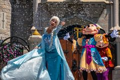 Elsa, Minnie and Mickey on  Mickey`s Royal Friendship Faire on Cinderella Castle in Magic Kingdom at Walt Disney World Resort  2. Orlando, Florida. May 17, 2019 stock image