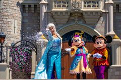 Elsa, Minnie and Mickey on  Mickey`s Royal Friendship Faire on Cinderella Castle in Magic Kingdom at Walt Disney World Resort  3. Orlando, Florida. May 17, 2019 royalty free stock image
