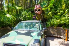 Orlando, Florida - May 09, 2018: Jurassic Park dinosaur and jeep at Universal Studios Islands of Adventure theme park. In Orlando, Florida on May 09, 2018 Royalty Free Stock Images