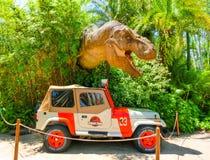 Orlando, Florida - May 09, 2018: Jurassic Park dinosaur and jeep at Universal Studios Islands of Adventure theme park. In Orlando, Florida on May 09, 2018 Stock Photos