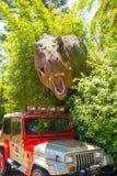Orlando, Florida - May 09, 2018: Jurassic Park dinosaur and jeep at Universal Studios Islands of Adventure theme park. In Orlando, Florida on May 09, 2018 Royalty Free Stock Photos