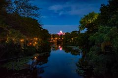Panoramic view of Expedition Everest mountain, river and rainforest on blue night background in Animal Kingdom  1. Orlando , Florida. May 03, 2019.Panoramic view stock images