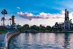 Panoramic view of vintage plane, Island of Adventure lighthouse and Chocolate Emporium restaurant at Universal Studios area . Orlando, Florida. May 21, 2019 stock photography