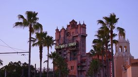 Top view of The Hollywood Tower Hotel, known as the Tower of Terror and palm trees at Hollywood Studios in the Walt Disney World a. Orlando, Florida. May 20 stock video footage