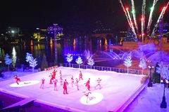 Artist group skating at Christmas Show on ice on colorful background with fireworks in International Drive area. Orlando, Florida. November 19, 2018. Artist royalty free stock image