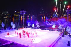 Artist group skating at Christmas Show on ice on colorful background with fireworksin International Drive area. Orlando, Florida. November 17, 2018. Artist group royalty free stock image