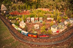Colorful Miniature train, bridge and Christmas Tree on forest background in International Drive area. Orlando, Florida. November 21, 2018. Colorful Miniature stock image
