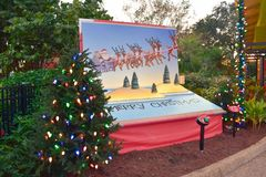 Colorful painting of Santa Claus, reindeer and Merry Christmas letters in International Drive area. stock photo