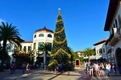 Decorated Christmas Tree on open mall background in Lake Buena Vista area. Orlando, Florida. November 20, 2018 Decorated Christmas Tree on open mall background royalty free stock image