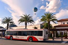 Disney Bus on air balloon and lightblue cloudy background in Lake Buena Vista.