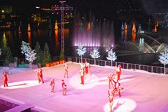 End of Christmas Show on ice on colorful background with holidays trees over the lake in International Drive area. Orlando, Florida. November 19, 2018. End of royalty free stock images
