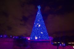 Iluminated Christmas Tree on cloudy sky background in International Drive area. Orlando, Florida. November 17, 2018. Iluminated Christmas Tree on cloudy sky stock images