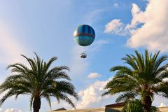 Palms Trees and air balloon on lightblue cloudy background in Lake Buena Vista. stock photography