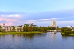 Panoramic l view of Victorian style Hotel and Boat Launch on colorful sunset sky background at Lake Buena Vista royalty free stock images