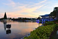 Panoramic view of stadium, Christmas Tree and lake on beautiful sunset background in International Drive area. Orlando, Florida. November 17, 2018. Panoramic royalty free stock photography