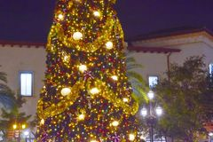 Partial view of illuminated and decorated Christmas Tree on open mall background in Lake Buena Vista . Orlando, Florida. November 18, 2018 Partial view of stock photos