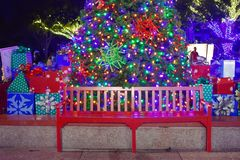 Red seat on Christmas Tree background in International Drive area. Orlando, Florida. November 17, 2018. Red seat on Christmas Tree background in International stock photography