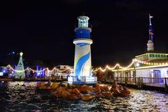 Seaworld lighthouse and illuminated Christmas Tree on night background in International Drive area. Orlando, Florida. November 19, 2018. Seaworld lighthouse and royalty free stock photo