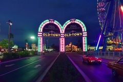 Vintage cars entering Saturday Nite Classic Car Show and Cruise, with arcs in background at O stock photos