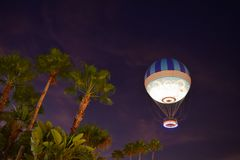 Caribbean Palm Trees and Air balloon on colorful sunset at Lake Buena Vista Area. royalty free stock photos