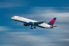 Delta Airlines aircraft taking off in airport area 1.