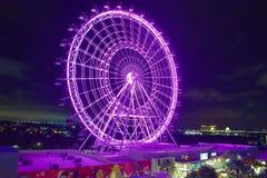 Iluminated Purple Big Wheel at night in International Drive area. royalty free stock photography