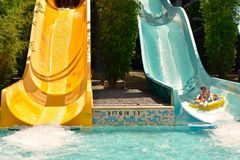 Little girls colorful slide water ride at Water Park in International Drive area. royalty free stock photo