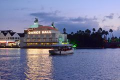 Security marine boat on Dance Hall Club and Palm trees background, at Lake Buena Vista area. royalty free stock images