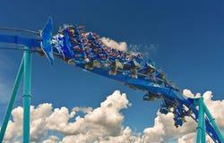 Group of people enjoy a fast Manta Roller coaster at Seaworld Orlando.