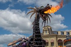 Maleficient dragon throwing fire in Disney Festival of Fantasy Parade at Magic Kigndom 5