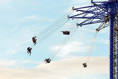 People joyful and frightened ride around International Drive in Orlando Star Flyer. stock photos