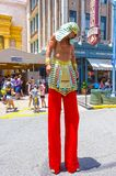 ORLANDO, FLORIDA, USA - MAY 08, 2018: Entrance to Revenge of the Mummy ride at Universal Studios Orlando. ORLANDO, FLORIDA, USA - MAY 08, 2018: The man on stilts Stock Images