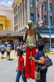 ORLANDO, FLORIDA, USA - MAY 08, 2018: Entrance to Revenge of the Mummy ride at Universal Studios Orlando. ORLANDO, FLORIDA, USA - MAY 08, 2018: The man on stilts Royalty Free Stock Images