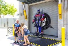 ORLANDO, FLORIDA, USA - MAY 08, 2018: Universal Studios. Entrance of Transformers 3D ride. ORLANDO, FLORIDA, USA - MAY 08, 2018: People making photo at Royalty Free Stock Photo