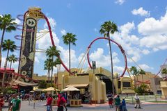ORLANDO, FLORIDA, USA - MAY 08, 2018: Roller coaster Rock it at Universal Studios park. ORLANDO, FLORIDA, USA - MAY 08, 2018: The people going near Roller Stock Image