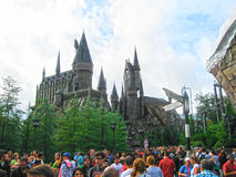 Orlando, USA - January 02, 2014: Visitors enjoying the Harry Potter themed attractions and shops at the Hogsmeade. Orlando, United States of America - January 02 Stock Image